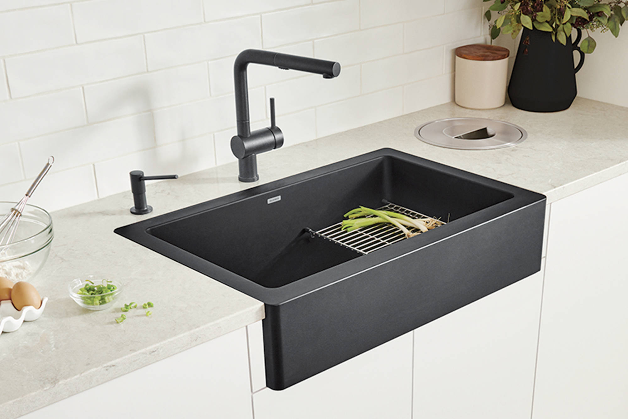 The VINTERA farmhouse kitchen sink collection is available in an array of colours, including concrete grey, truffle and coal black.