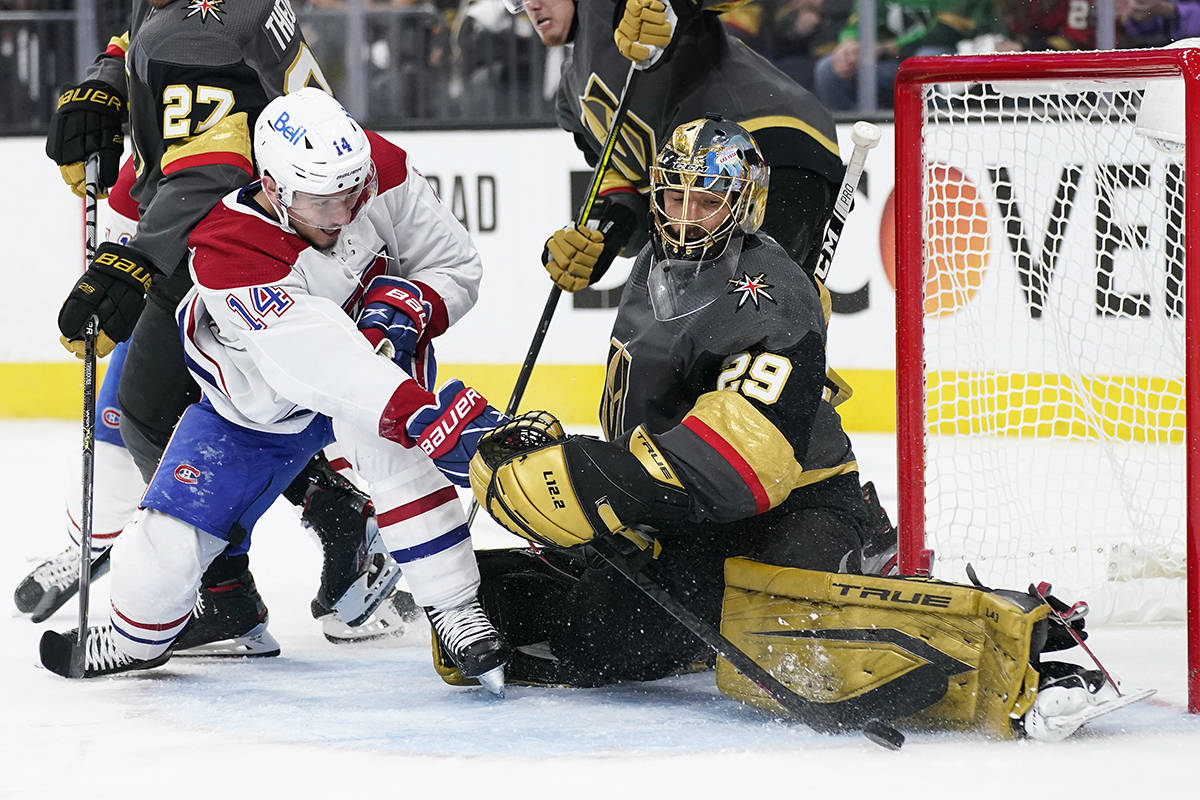 Vegas Golden Knights goaltender Marc-Andre Fleury (29) blocks a shot by Montreal Canadiens center Nick Suzuki (14) during the third period in Game 2 of an NHL hockey Stanley Cup semifinal playoff series, Wednesday, June 16, 2021, in Las Vegas. (AP Photo/John Locher)