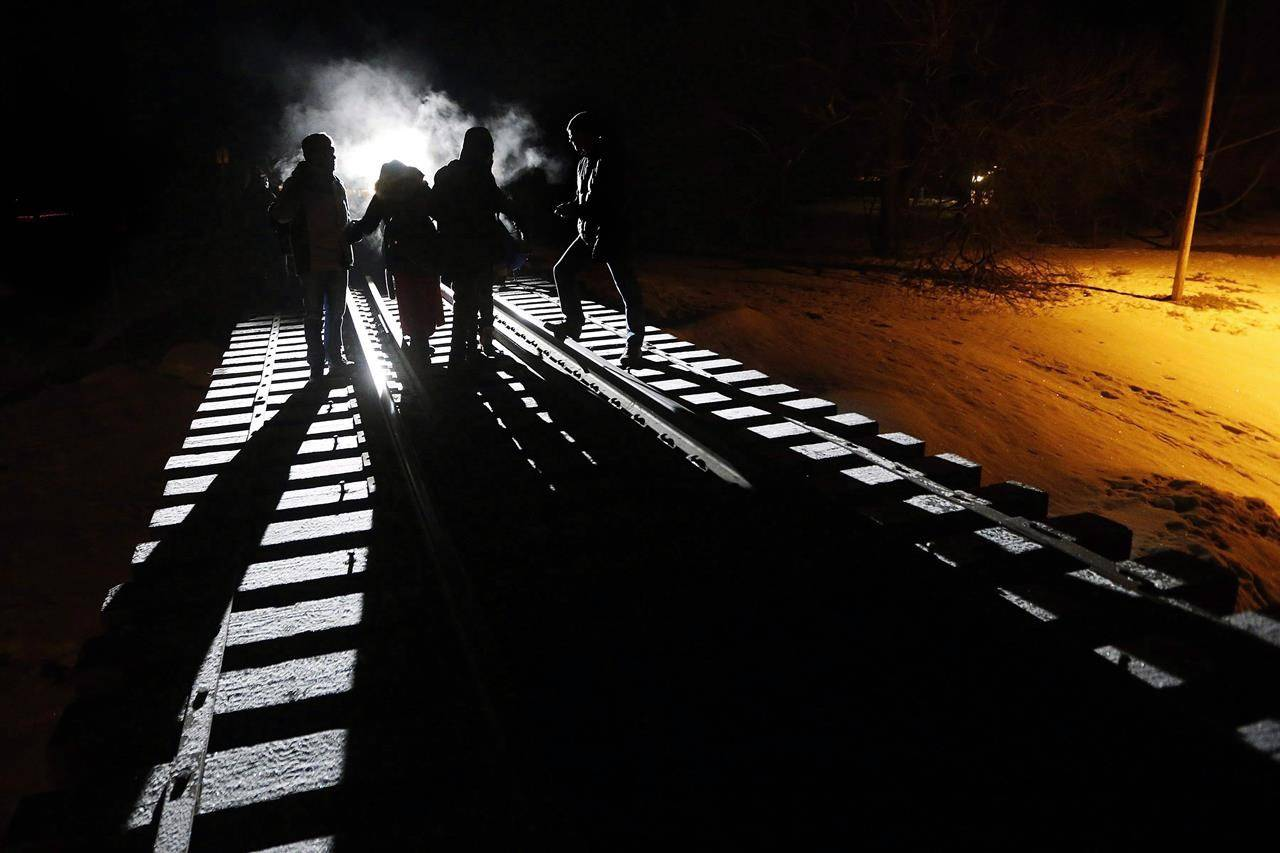 Early Sunday morning, February 26, 2017, migrants from Somalia cross into Canada illegally from the United States by walking down this train track into the town of Emerson, Man., where they will seek asylum at Canada Border Services Agency. THE CANADIAN PRESS/John Woods