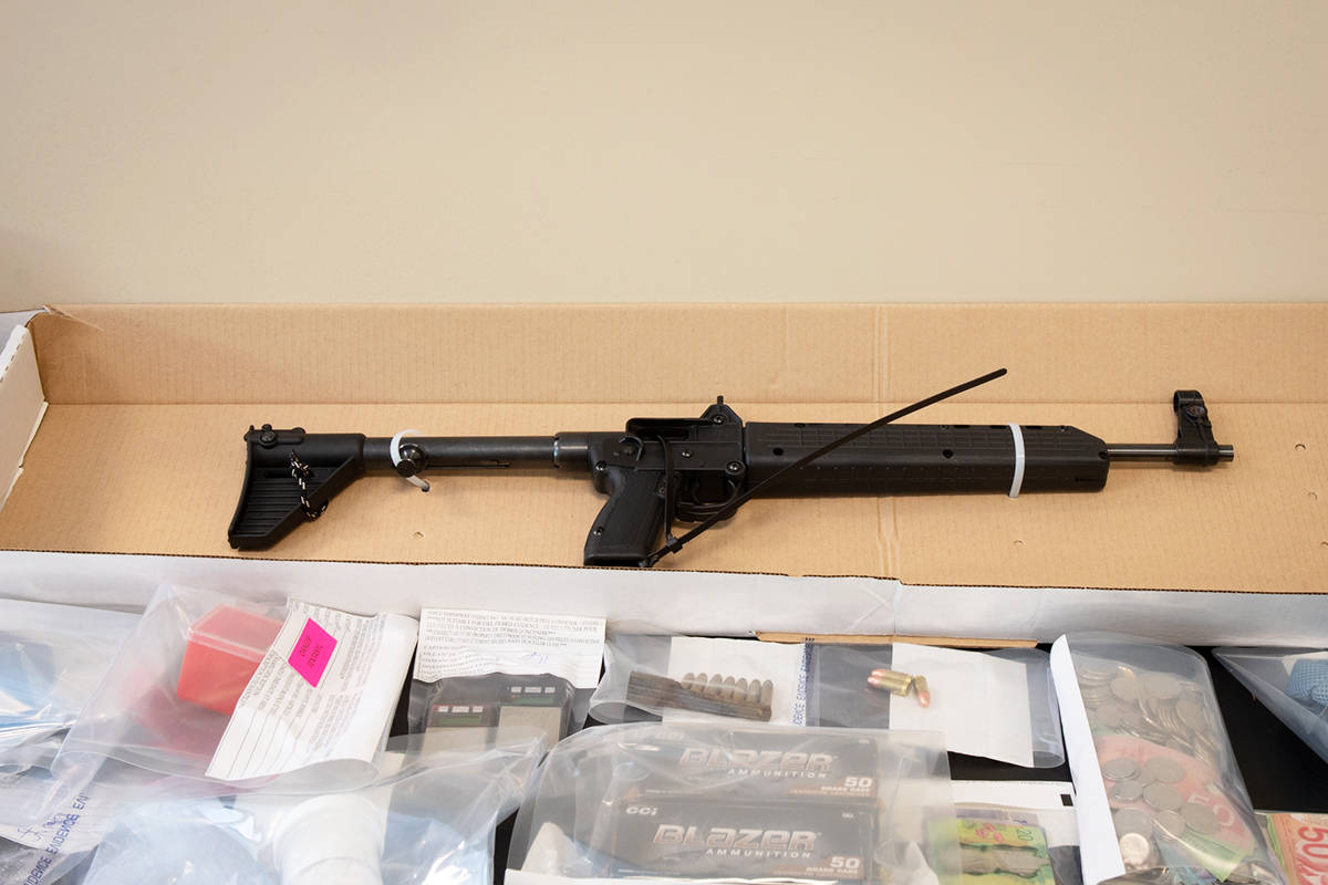 Ridge Meadows RCMP seized drugs, cash and guns from a house on Lougheed Highway and 221 Street. (Special to The News)