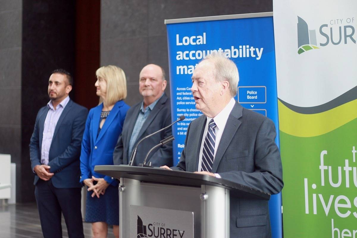 Surrey Mayor Doug McCallum speaks at a press conference in August 2019 about provincial government approval of the city's change to a municipal force, joined by councillors (from left) Mandeep Nagra, Allison Patton and Doug Elford. Members of the National Police Federation claim there is still no transition plan in place although Surrey RCMP's contract with the city is due to end March 31.(File photo)