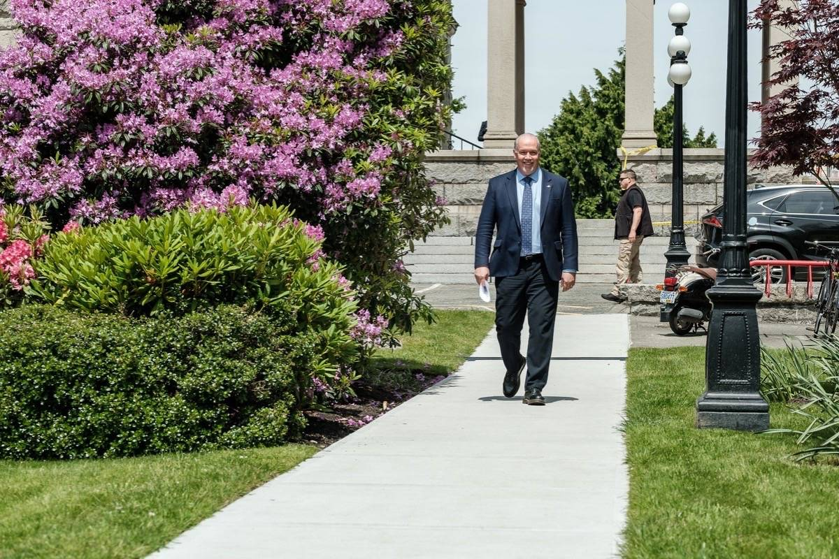 B.C. Premier John Horgan leaves his office for a news conference in the legislature rose garden, June 3, 2020. (B.C. government photo)