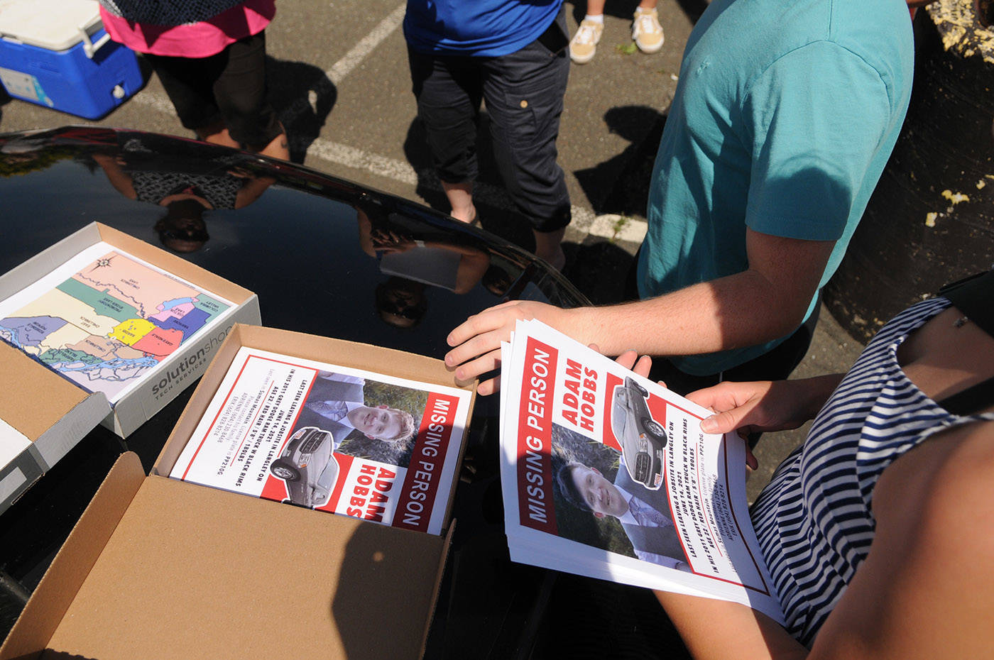 Family and friends of missing Abbotsford man, Adam Hobbs, gather to distribute posters in Chilliwack on Thursday, June 17, 2021. (Jenna Hauck/ Chilliwack Progress)