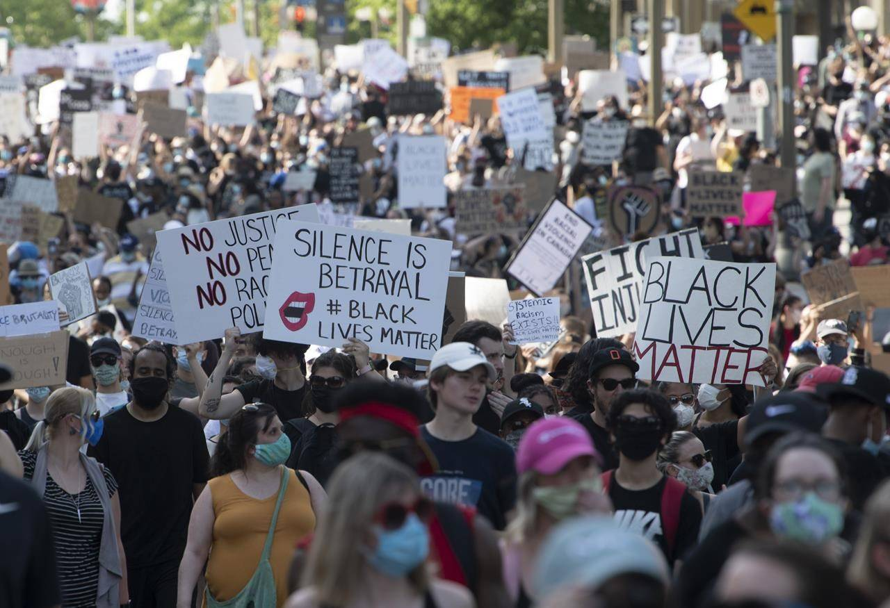 Thousands of protesters make their way through the downtown core during a Black Lives Matter protest in Ottawa, Friday June 5, 2020. THE CANADIAN PRESS/Adrian Wyld