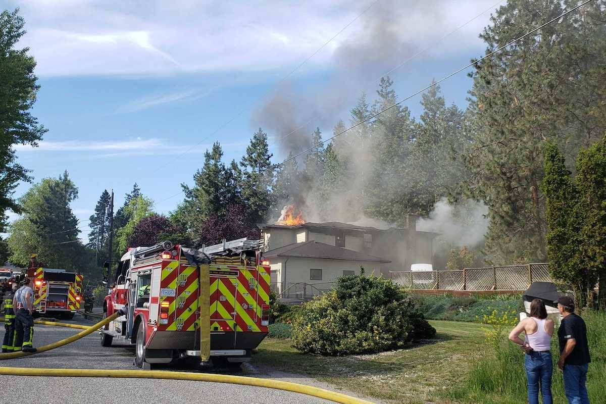 Flames shoot from the home's roof. (Amandalina Letterio - Kelowna Capital News)