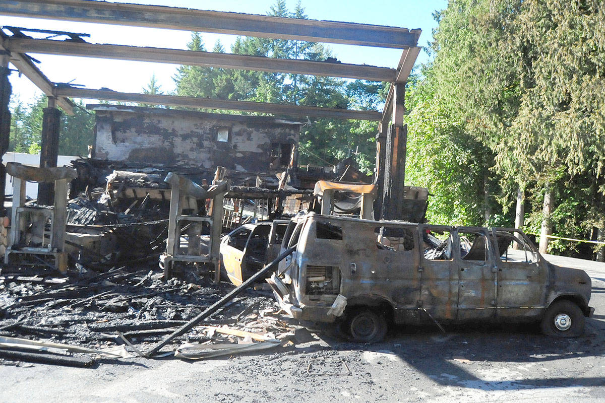 The remains of the Mid-Island Co-op in Whiskey Creek along the Alberni Highway on Friday, June 18, after a blaze the day before devastated the gas station. (Michael Briones photo)