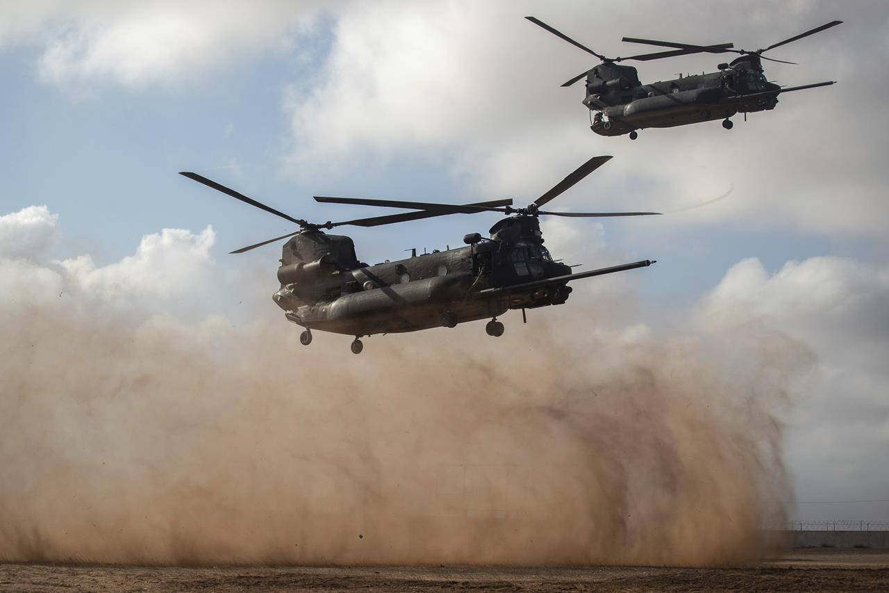Helicopters carrying U.S and Moroccan special forces take part in a drill as part of the African Lion military exercise, in Tafraout base, near Agadir, Morocco, Monday, June 14, 2021. With more than 7,000 participants from nine nations and NATO, African Lion is U.S. Africa Command's largest exercise. (AP Photo/Mosa'ab Elshamy)