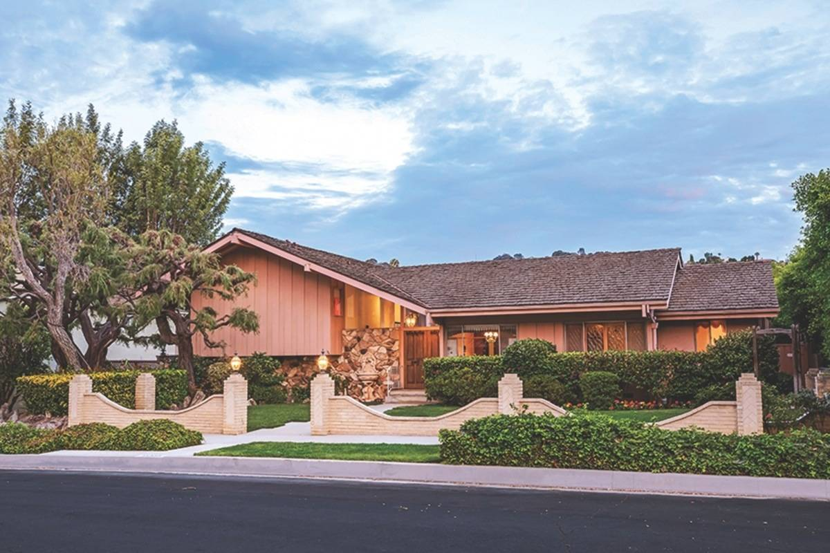 This undated file photo provided by Ernie Carswell & Partners shows the home featured in the opening and closing scenes of The Brady Bunch in Los Angeles. Do you know the occupation of Mike Brady, the father in this show about a blended family? (Anthony Barcelo/Ernie Carswell & Partners via AP, File)