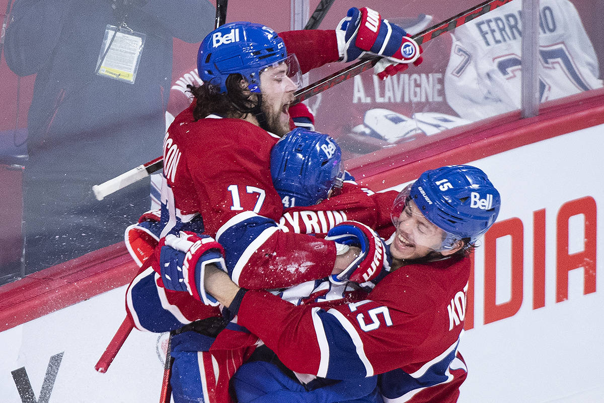 Montreal Canadiens' Josh Anderson (17) celebrates with teammates Paul Byron (41) and Jesperi Kotkaniemi (15) after scoring against the Vegas Golden Knights during overtime in Game 3 of the NHL Stanley Cup semifinal in Montreal, Friday, June 18, 2021. THE CANADIAN PRESS/Graham Hughes