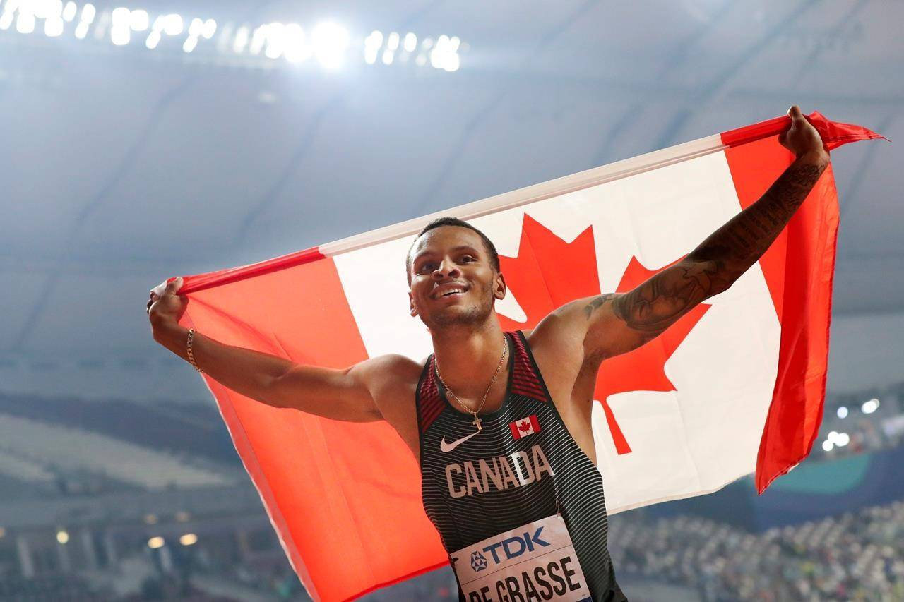 Andre de Grasse, of Canada, celebrates after winning the silver medal in the men's 200 meters at the World Athletics Championships in Doha, Qatar, Tuesday, Oct. 1, 2019. THE CANADIAN PRESS/AP, Hassan Ammar
