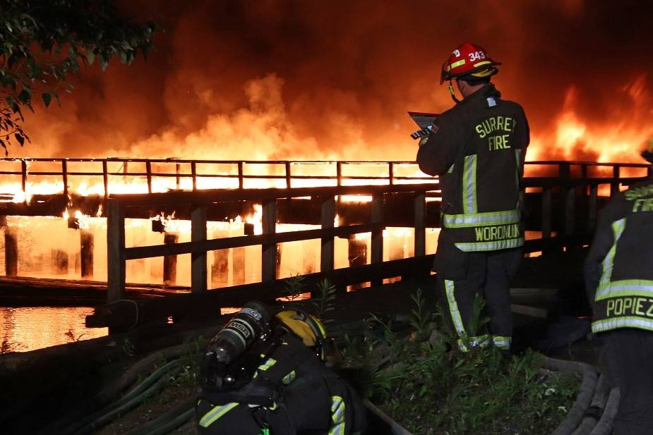 Surrey Fire Service battled a dock fire along the Fraser River late Friday night (June 18). It was on Musqueam Drive, near Industrial Road, around 10:45 p.m. (Photo: Shane MacKichan)