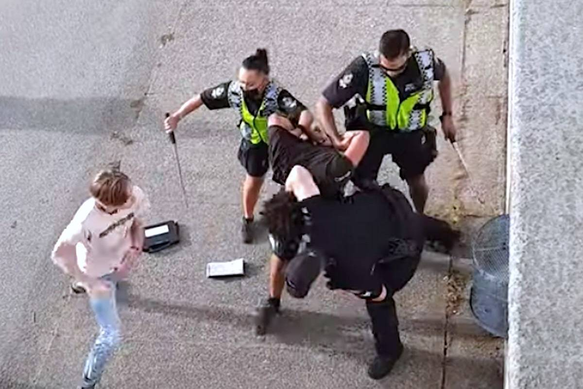 A North Vancouver man was arrested Friday and three police officers were injured after a 10-person broke out at English Bay on June 19, 2021. (Youtube/Screen grab)