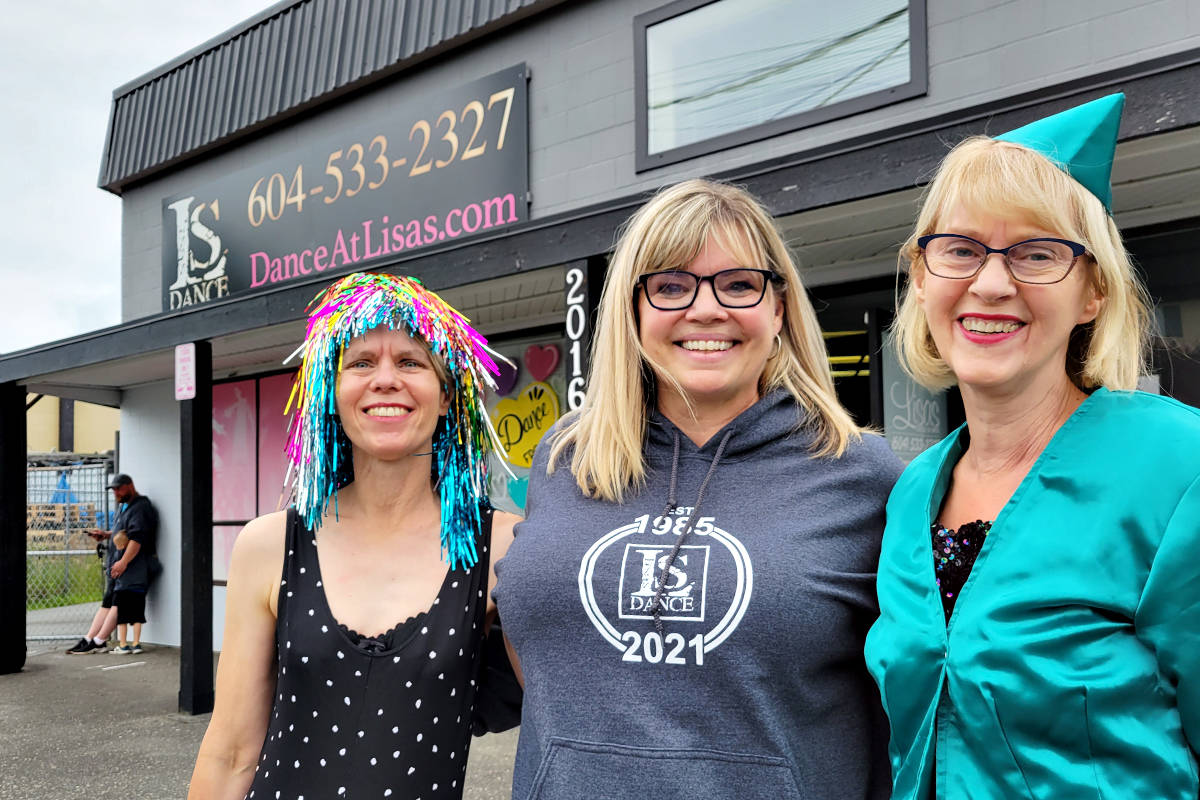 Kathy (L) and Janet Foss (R) showed up in the outfits from past school shows to say goodbye to Lisa Dew (centre), school founder, at a drive-by farewell bash on Saturday, June 19. (Dan Ferguson/Langley Advance Times)