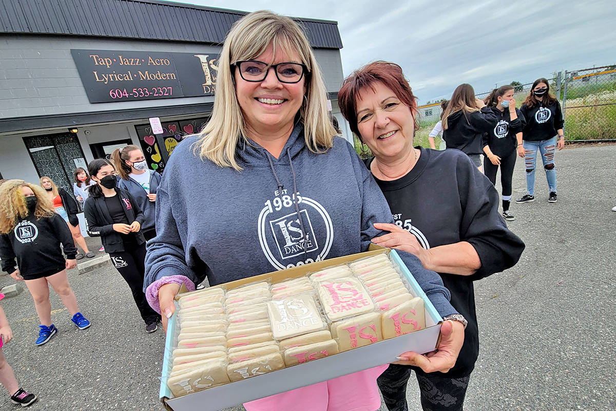 Friend Pam Johnson (R) showed up with baked treats at the last day of dancing at Lisa Dew's (L) school of dance on Saturday, June 19. (Dan Ferguson/Langley Advance Times)