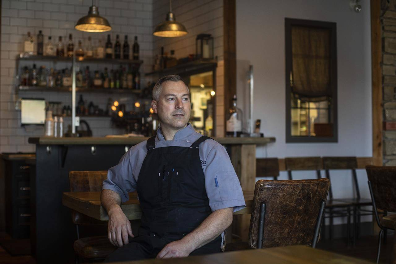 Blair Lebsack, owner of RGE RD restaurant, poses for a portrait in the dining room, in Edmonton, Friday, June 18, 2021. Canadian restaurants are having to find ways to deal with the rising cost of food. THE CANADIAN PRESS/Jason Franson