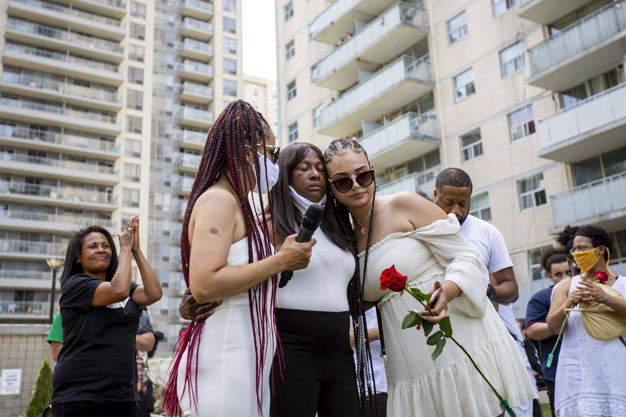 Regis Korchinski-Paquet's mother, Claudette Beals, is comforted after singing at a public memorial and walk for justice held to honour the woman who fell to her death from a balcony while police were in her apartment in Toronto, Saturday, July 25, 2020. Several Black and Indigenous families whose loved ones have been harmed and killed by police came together in Ottawa to mark Juneteenth and demand accountability and changes to the justice system. THE CANADIAN PRESS/Carlos Osorio