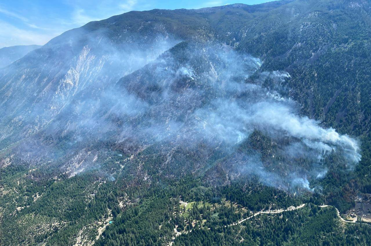 A portion of the George Road wildfire burns near Lytton, B.C. in this Friday, June 18, 2021 handout photo. THE CANADIAN PRESS/HO, BC Wildfire Service *MANDATORY CREDIT*