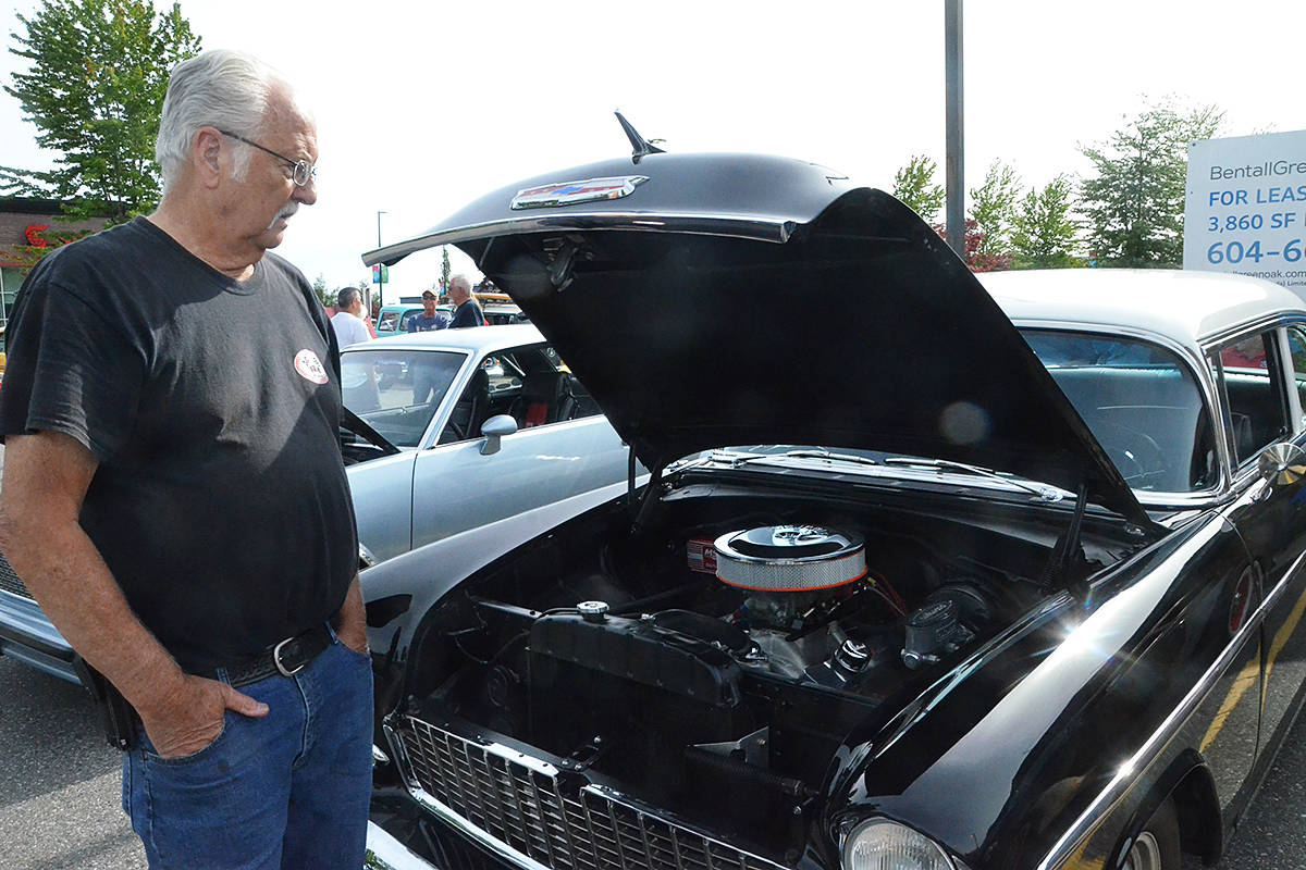 Pat Bolton showed off the engine to his Bel Air, a fully restored creation he recently bought. (Matthew Claxton/Langley Advance Times)
