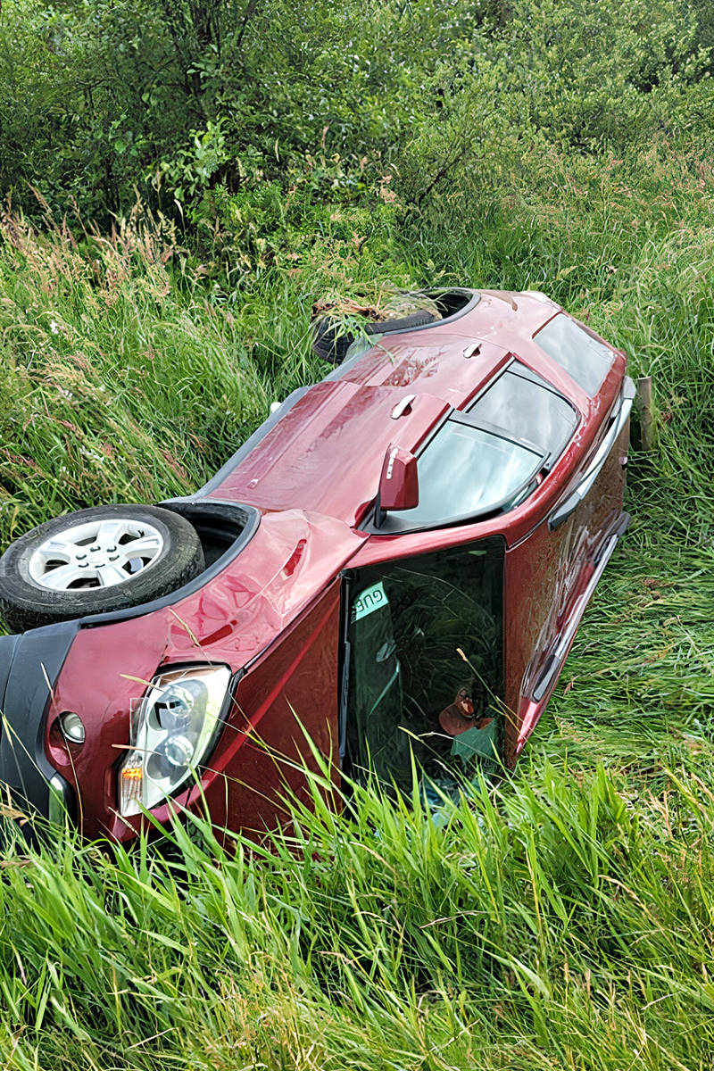This GMC Acadian ended up in a ditch after it collided with an oncoming GMC Terrain that crossed over the centre line in Langley. The people in the Acadia are thanking the Good Samaritans who came to their aid Saturday night, June 19. (Special to Langley Advance Times)