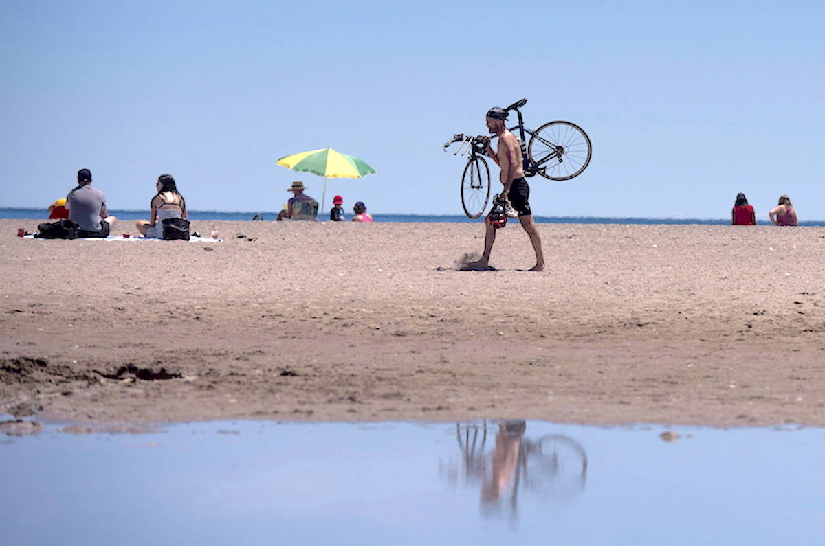 People enjoy the sun at Woodbine Beach on June 19, 2018. THE CANADIAN PRESS/ Tijana Martin