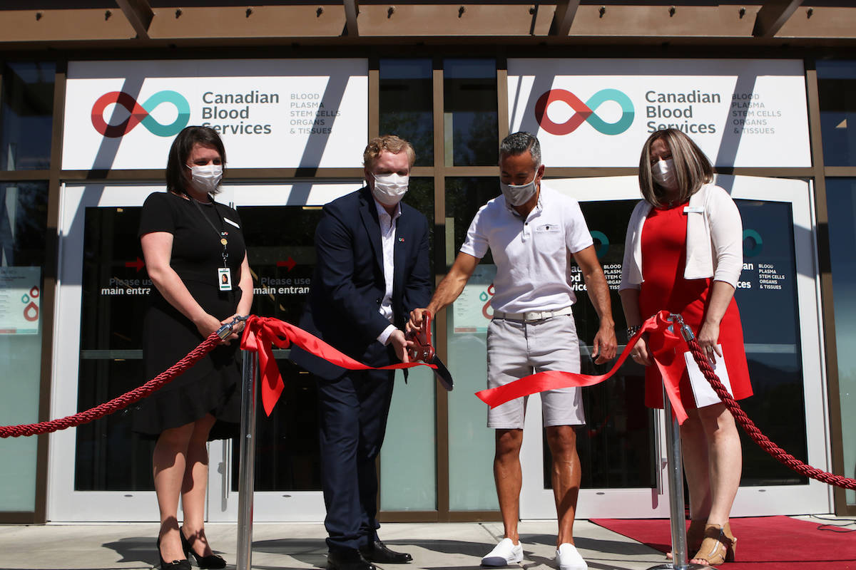 Kelowna Mayor Colin Basran, middle right, participates in a ribbon-cutting ceremony in honour of the launch of Kelowna's plasma donor centre at Orchard Plaza Mall on June 22. From left to right: Canadian Blood Services' business development manager Janna Pantella, Canadian Blood Services' operational excellence manager Tyler Burke, Kelowna Mayor Colin Basran and Canadian Blood Services' centre manager Janine Johns. (Aaron Hemens/Capital News)