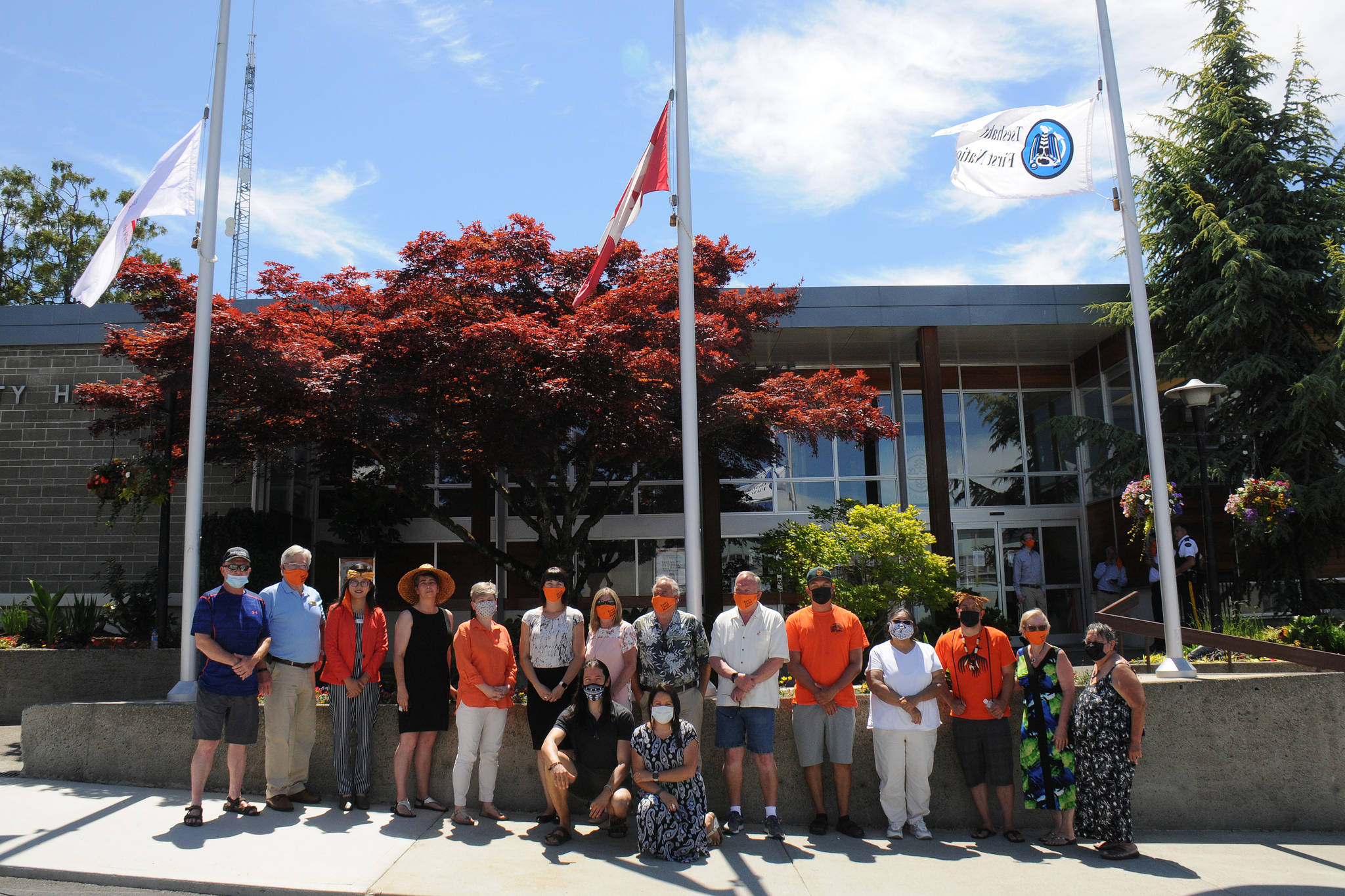 Council members, dignitaries and witnesses from the City of Port Alberni, Hupacasath First Nation and Tseshaht First Nation gather in front of city hall on June 21, 2021, National Indigenous Peoples Day, to raise the Tseshaht and Hupacasath flags. These flags will fly permanently on either side of the Canadian flag, and beside the city and provincial flags. (SUSAN QUINN/ Alberni Valley News)