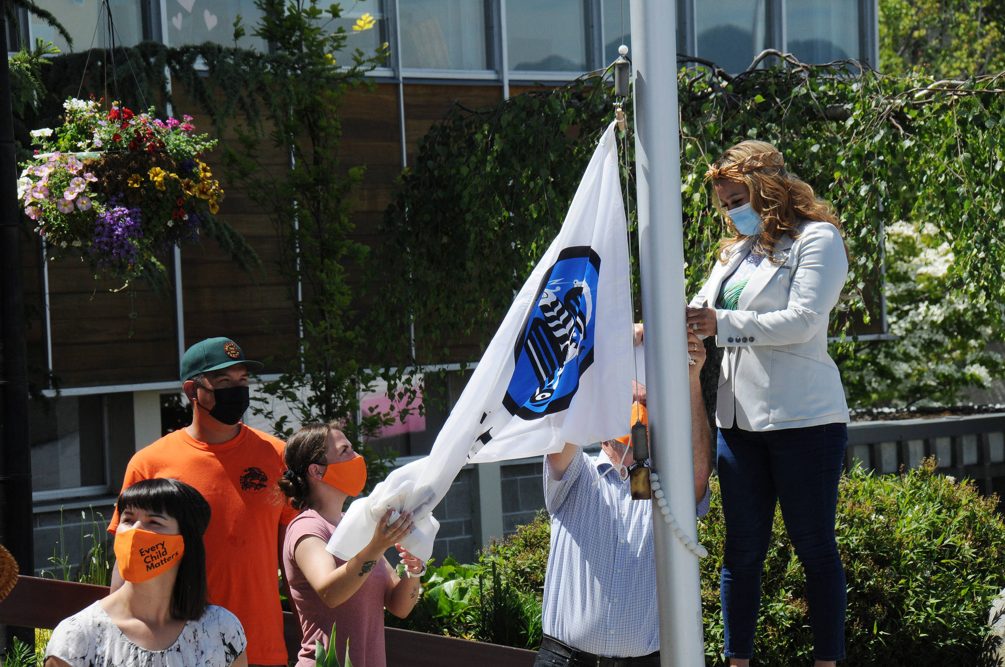 Members of Tseshaht First Nation prepare to raise their nation's flag in front of Port Alberni City Hall on Monday, June 21, 2021. (SUSAN QUINN/ Alberni Valley News)