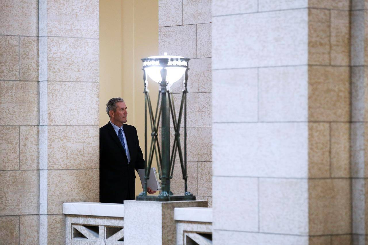 Manitoba premier Brian Pallister makes his way to question period at the Manitoba Legislature in Winnipeg, Wednesday, May 13, 2020.  THE CANADIAN PRESS/John Woods