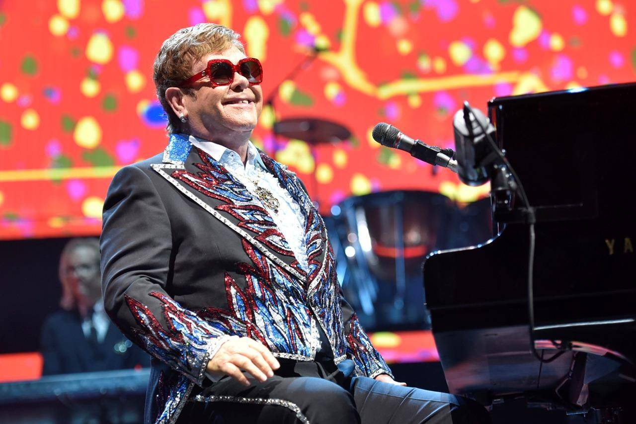FILE - Elton John performs during his Elton John Farewell Yellow Brick Road tour in Rosemont, Ill. on Feb 15, 2019. Elton John has announced the final dates for his farewell tour, which includes stops at big stadiums in the U.S. (Photo by Rob Grabowski/Invision/AP, File)
