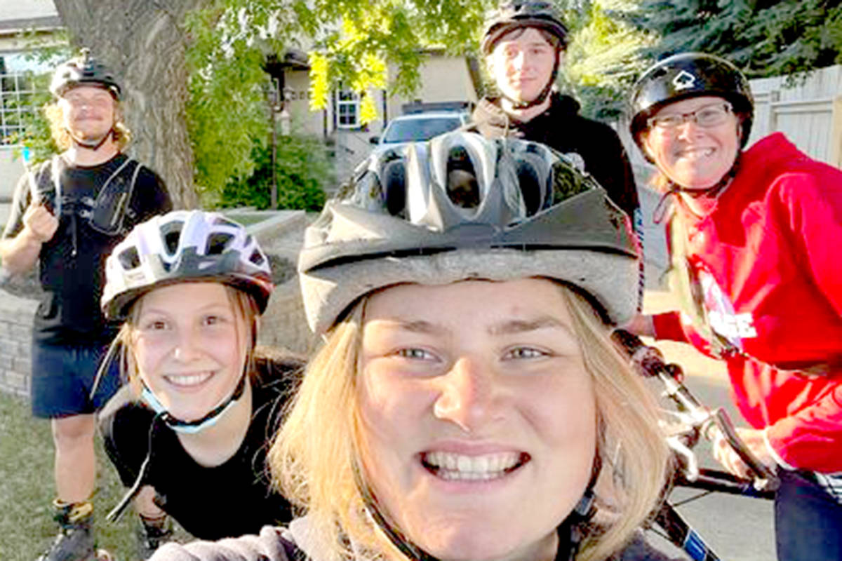 Aldergrove rollerblader Zach Choboter (back left) as his Blading for Bees team on their cross country journey. (Special to The Star)