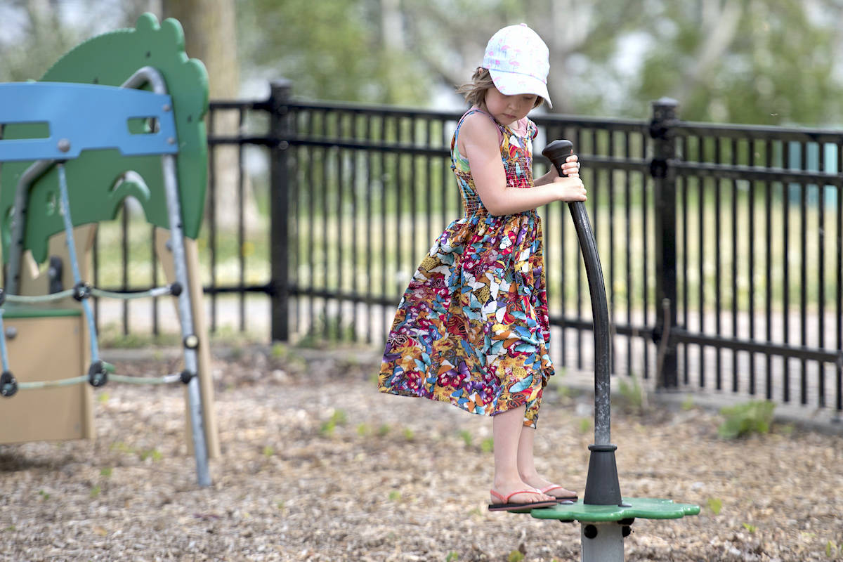 Seven-year-old Eva Mailhot Maclean plays in a playground in Montreal, Saturday, May 30, 2020. THE CANADIAN PRESS/Graham Hughes