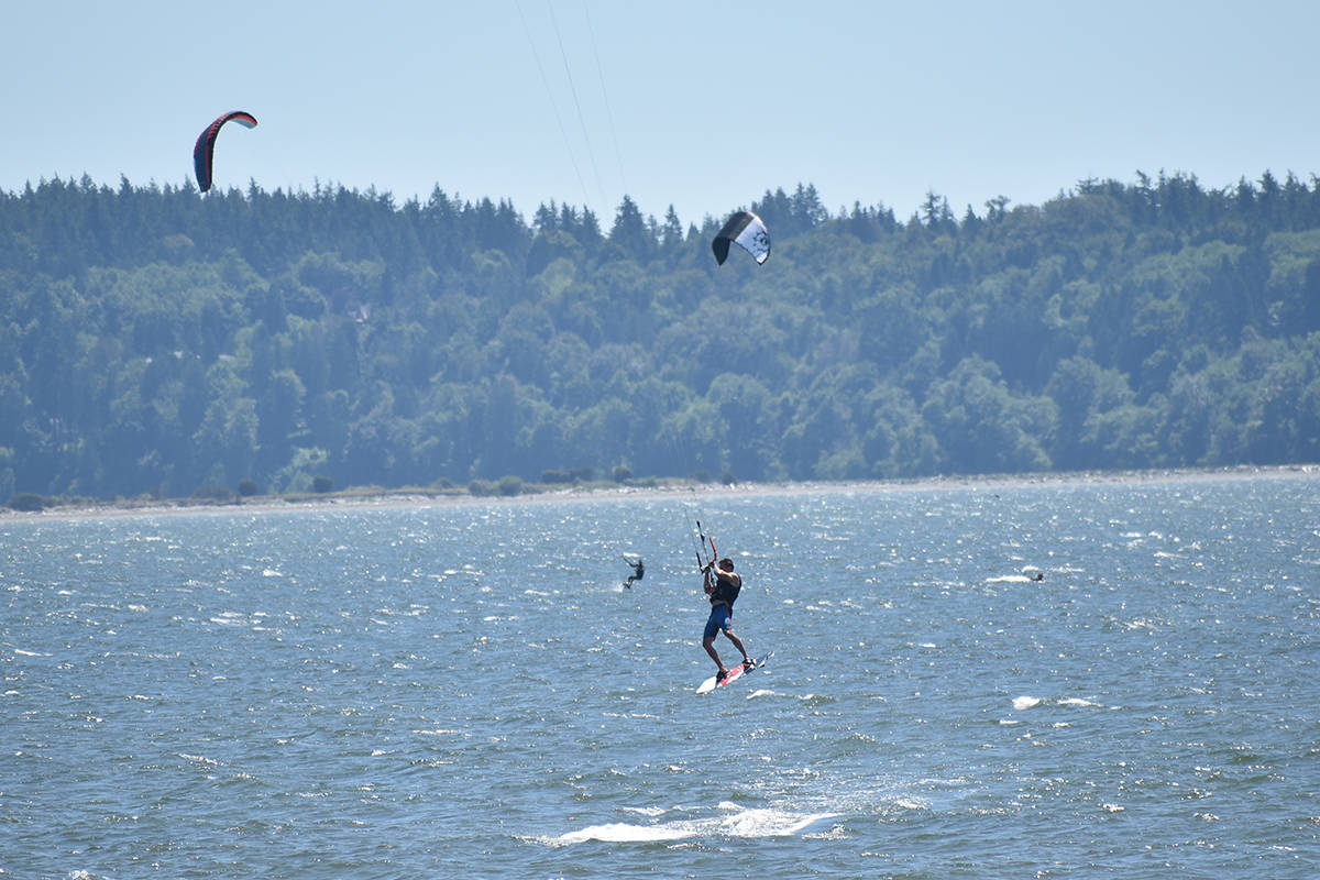 A kite surfer catches air in White Rock on Father's Day (June 20, 2021). That same evening, a Shiprider crew rescued a kite surfer who ran into trouble about four kilometres out into the bay. (Aaron Hinks photo)