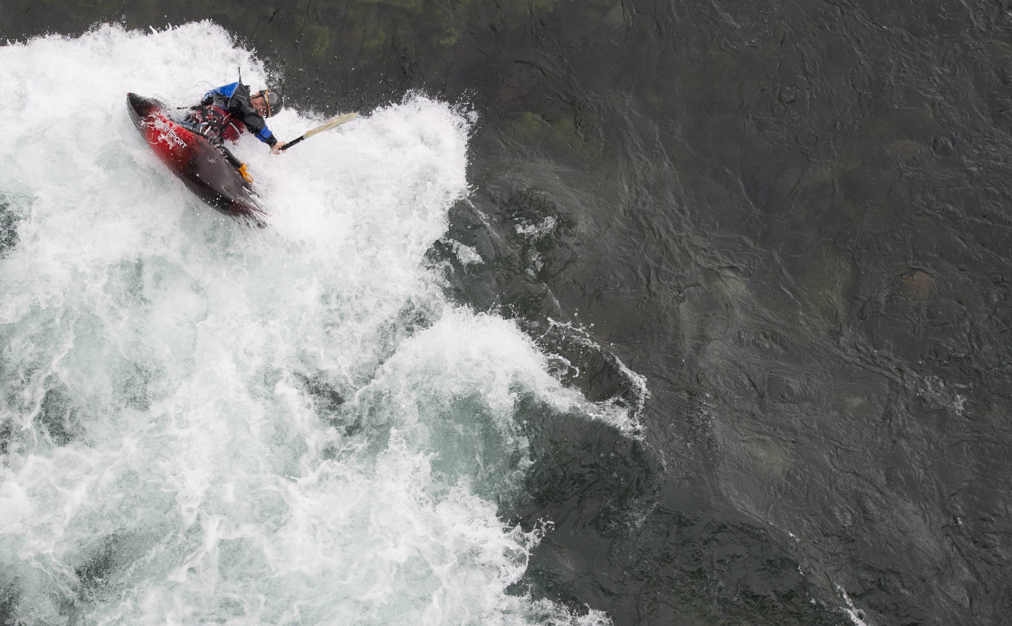 A whitewater kayaker does a roll as he paddles on the Yukon River in Whitehorse, YK, Friday, July, 22, 2016. THE CANADIAN PRESS/Jonathan Hayward