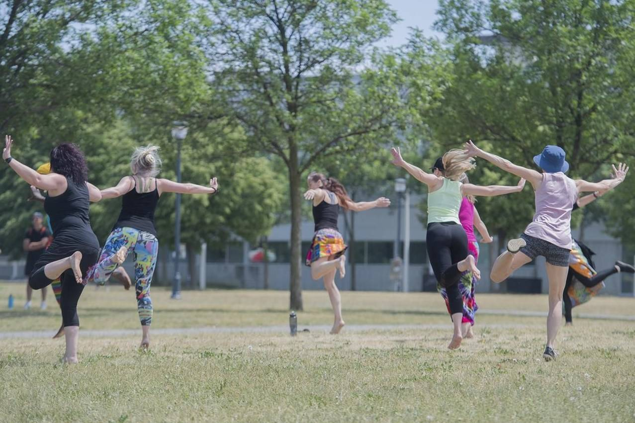 People stay physically distanced as they take part in a outdoor dance class in a park in Montreal on June 13, 2021. THE CANADIAN PRESS/Graham Hughes