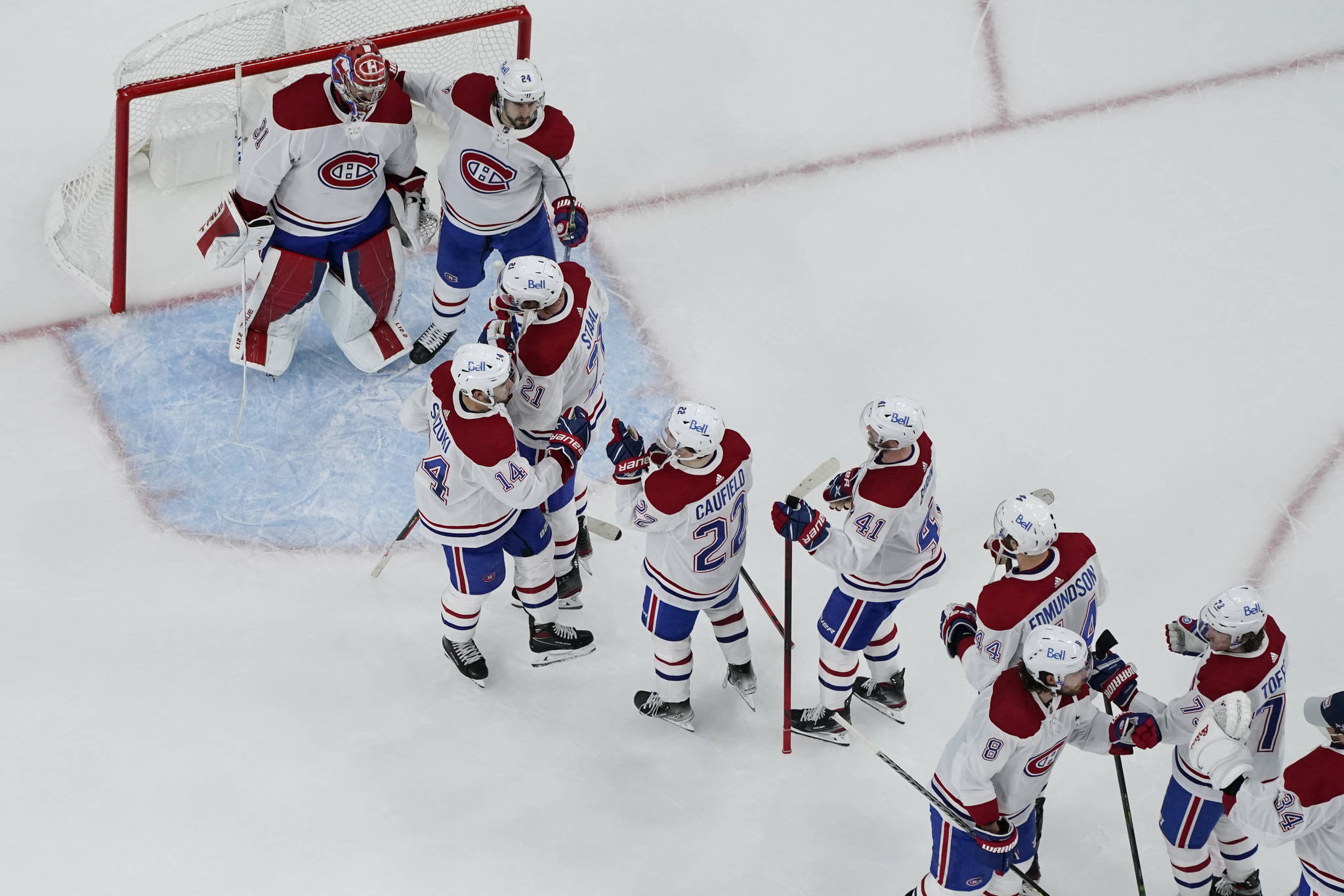 Montreal Canadiens celebrate after defeating the Vegas Golden Knights in Game 5 of an NHL hockey Stanley Cup semifinal playoff series Tuesday, June 22, 2021, in Las Vegas. (AP Photo/John Locher)