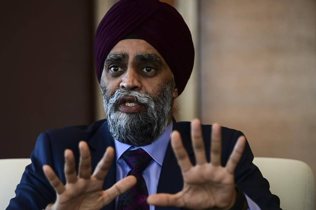 Minister of National Defence Harjit Sajjan takes part in a year-end interview with The Canadian Press at National Defence headquarters in Ottawa on Thursday, Dec. 17, 2020. THE CANADIAN PRESS/Sean Kilpatrick