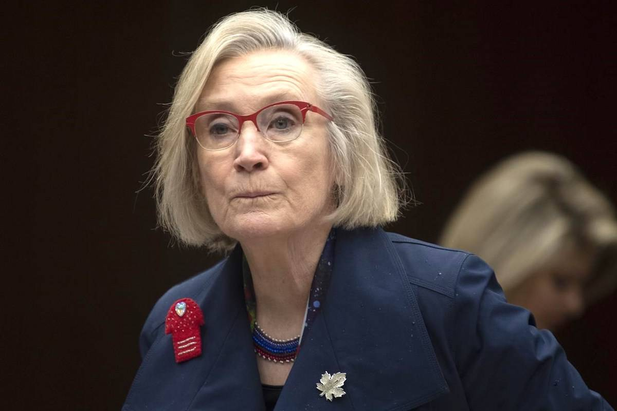 Crown-Indigenous Relations Minister Carolyn Bennett takes her seat as she waits to appear before the Indigenous and Northern Affairs committee in Ottawa on March 10, 2020. THE CANADIAN PRESS/Adrian Wyld