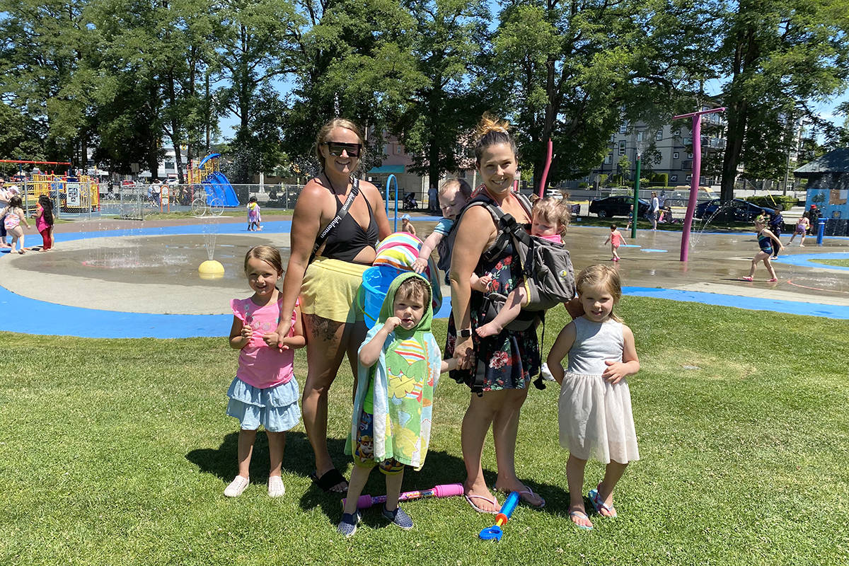 Jana Wooding (left) and her daughter joined friend Jaime Friesen with her four children at Douglas Park to cool off at the spray park on Thursday, June 24, 2021. (Joti Grewal/Langley Advance Times)