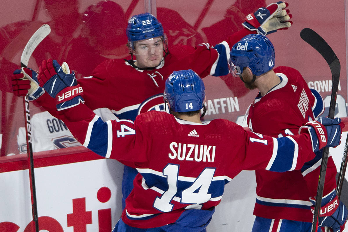 Montreal Canadiens right wing Cole Caufield (22) celebrates his goal against the Vegas Golden Knights with teammates Nick Suzuki (14) and Paul Byron (41) during second period NHL Stanley Cup playoff hockey semifinal action Thursday, June 24, 2021 in Montreal. THE CANADIAN PRESS/Ryan Remiorz