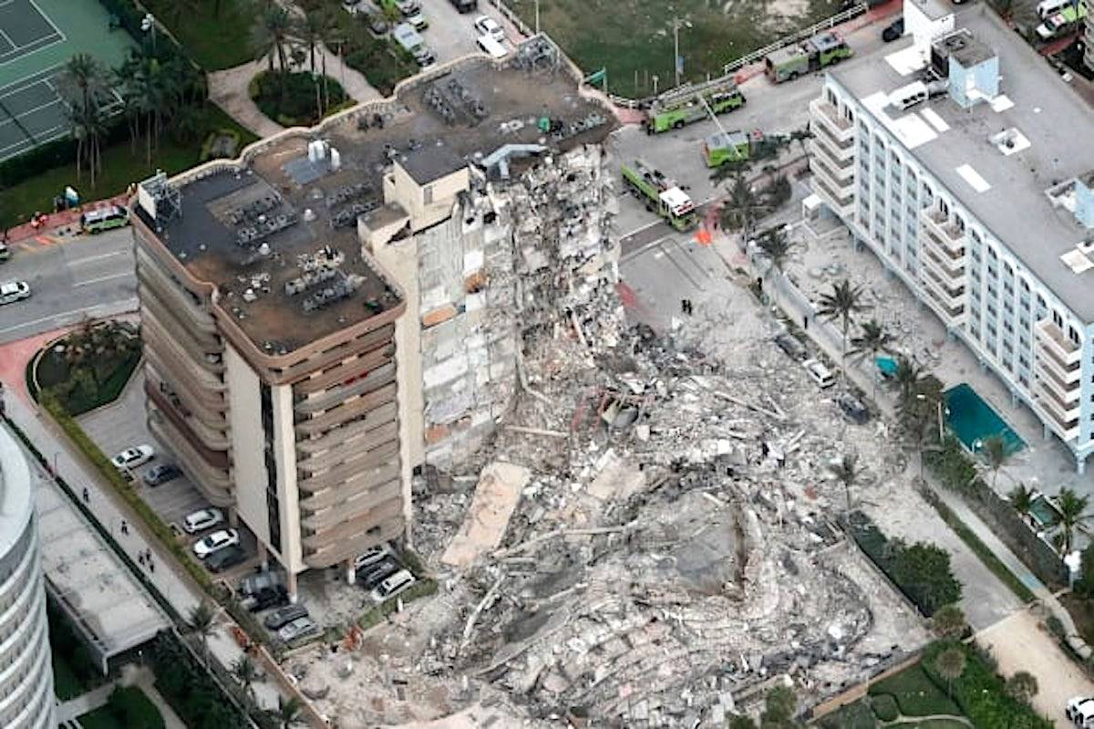 This aerial photo shows part of the oceanfront Champlain Towers South Condo after it collapsed early Thursday. (Amy Beth Bennett/AP)