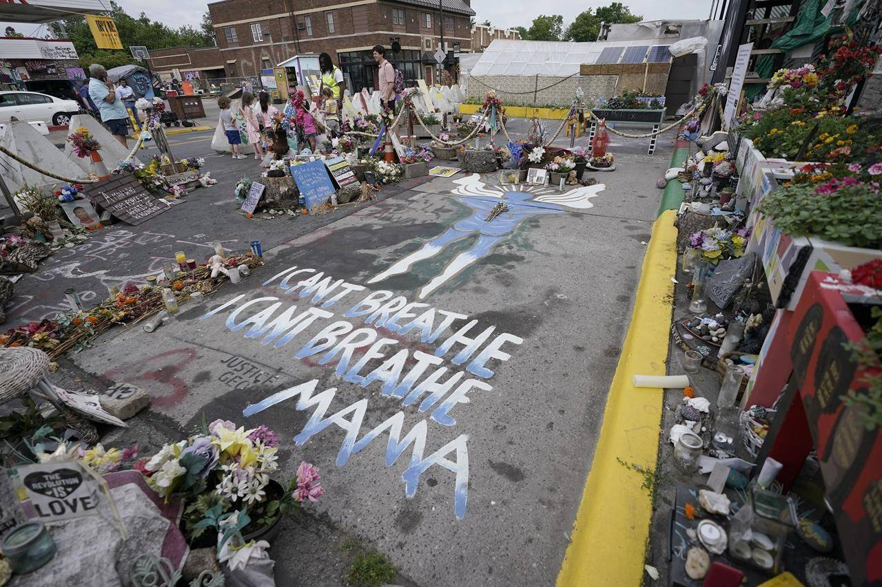 A general view shows the site where George Floyd was killed by then Minneapolis Police officer Derek Chauvin, as the kids took a field trip to the memorial, Thursday, June 24, 2021, in Minneapolis. (AP Photo/Julio Cortez)