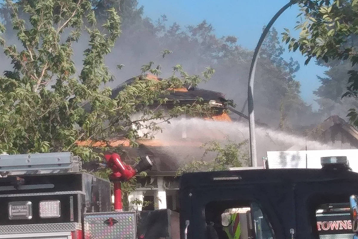 Flames consumed part of two Murrayville homes on Friday afternoon. Fire crews are on scene. (Ryan Uytdewilligen/Black Press Media)