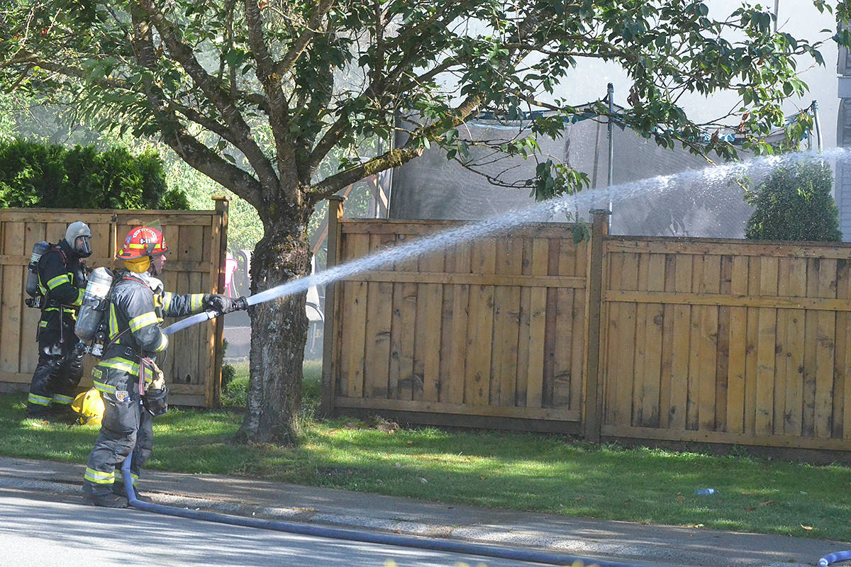 Firefighters battled a blaze at a home in Murrayaville near Langley Fundamental School on Friday afternoon. (Matthew Claxton/Langley Advance Times)