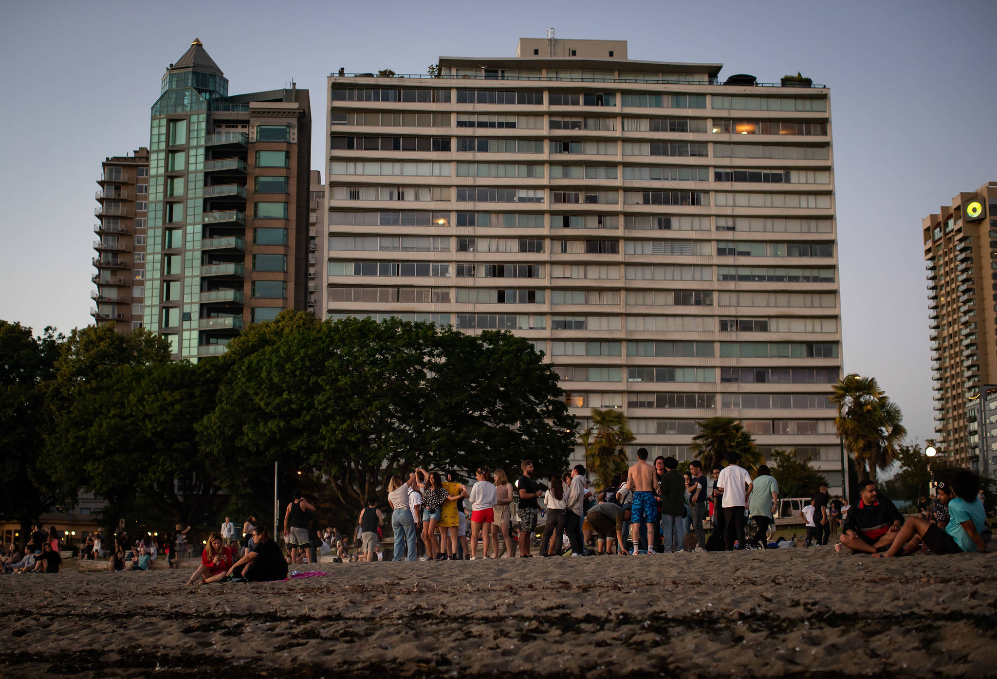 People dance and gather at English Bay Beach amidst a heat wave, in Vancouver, B.C., on Monday, June 21, 2021. THE CANADIAN PRESS/Darryl Dyck