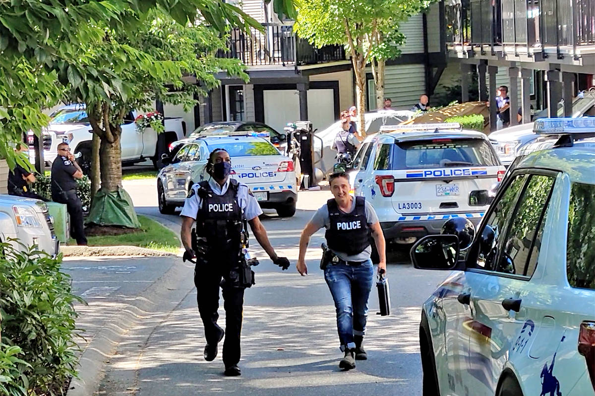 An 11-hour standoff in a Langley townhouse complex in the 20100 block of 68th Avenue ended around 10 a.m. Saturday morning, June 26, when a man was transported to hospital by ambulance in what RCMP described as a 'mental health' incident. (Dan Ferguson/Langley Advance Times)