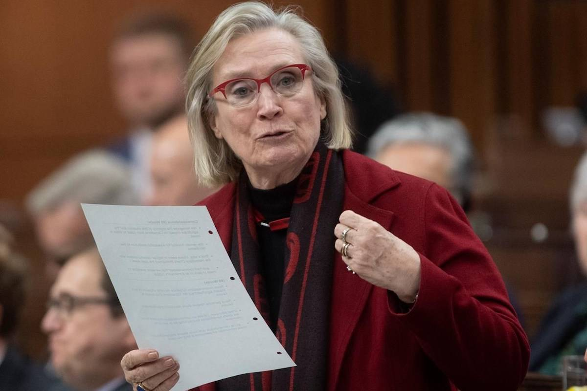 Crown-Indigenous Relations Minister Carolyn Bennett responds to a question during Question Period in the House of Commons Tuesday, February 25, 2020 in Ottawa. Asettlement has been reached in a class action lawsuit against the federal government involving hundreds of First Nations people left out of residential-school compensation. THE CANADIAN PRESS/Adrian Wyld