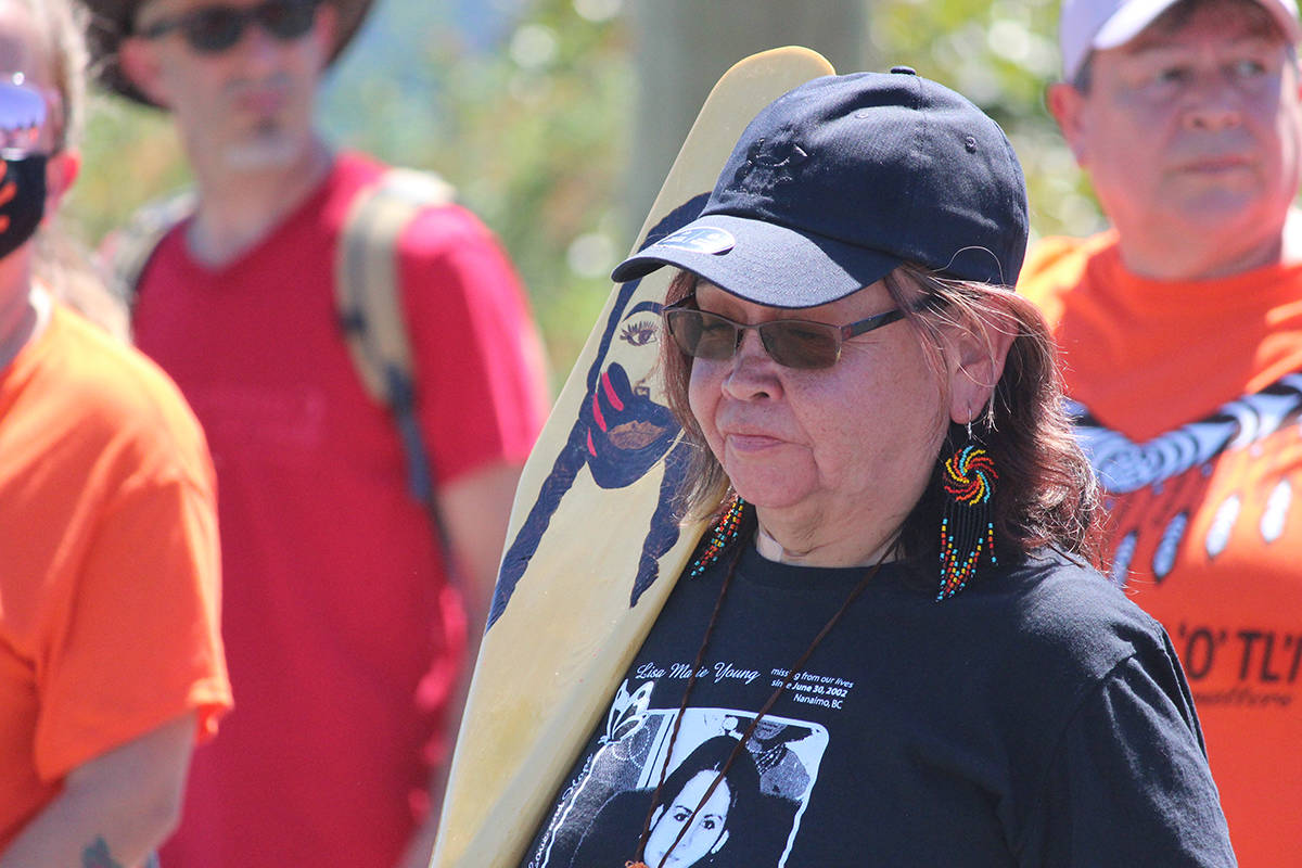 Carol Frank, aunt of Lisa Marie Young, missing since June 2002, in a march seeking justice for her niece on June 26. (Karl Yu/News Bulletin)
