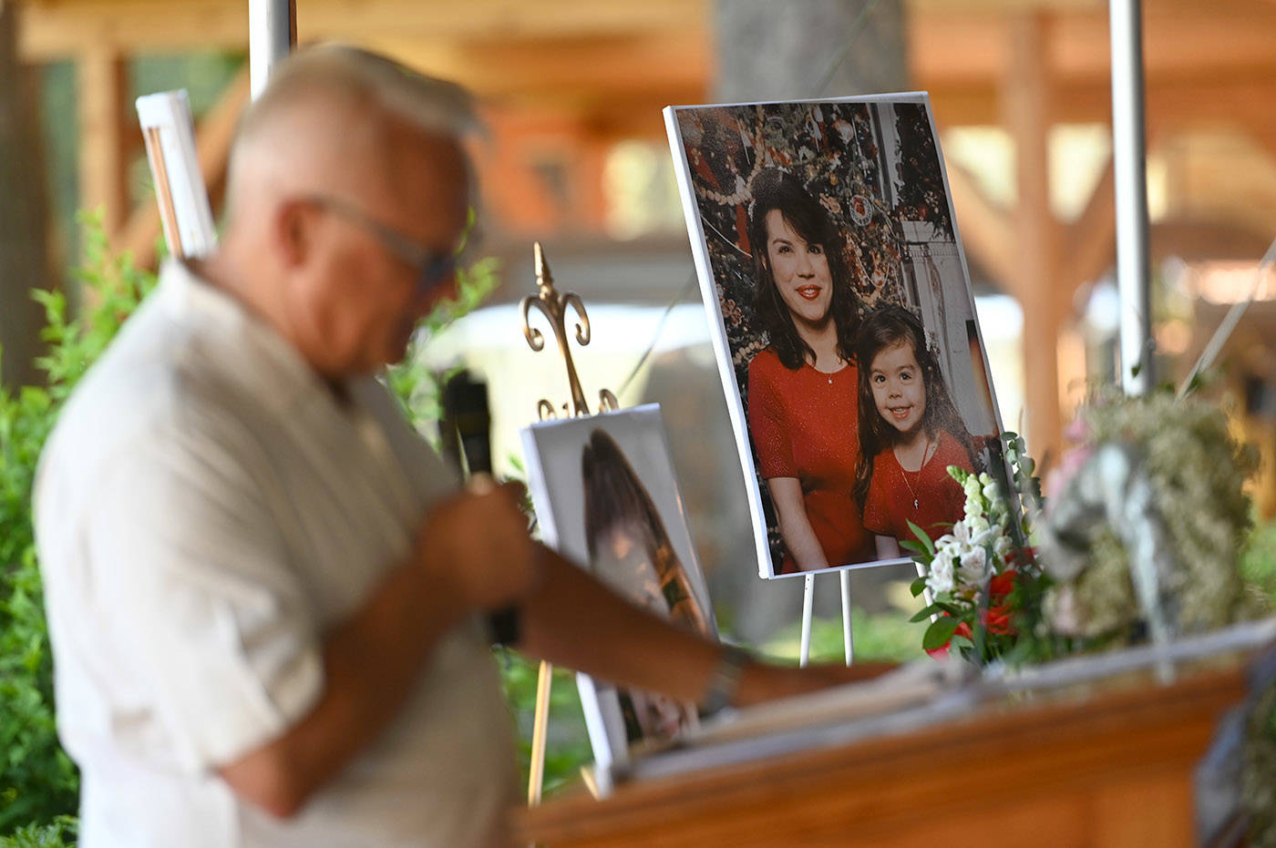 A photo of Shaelene Bell when she was a child with her mother, Alina Durham, sits on a table during Bell's celebration of life at Sandpiper Resort on Saturday, June 26, 2021. (Jenna Hauck/ Chilliwack Progress)