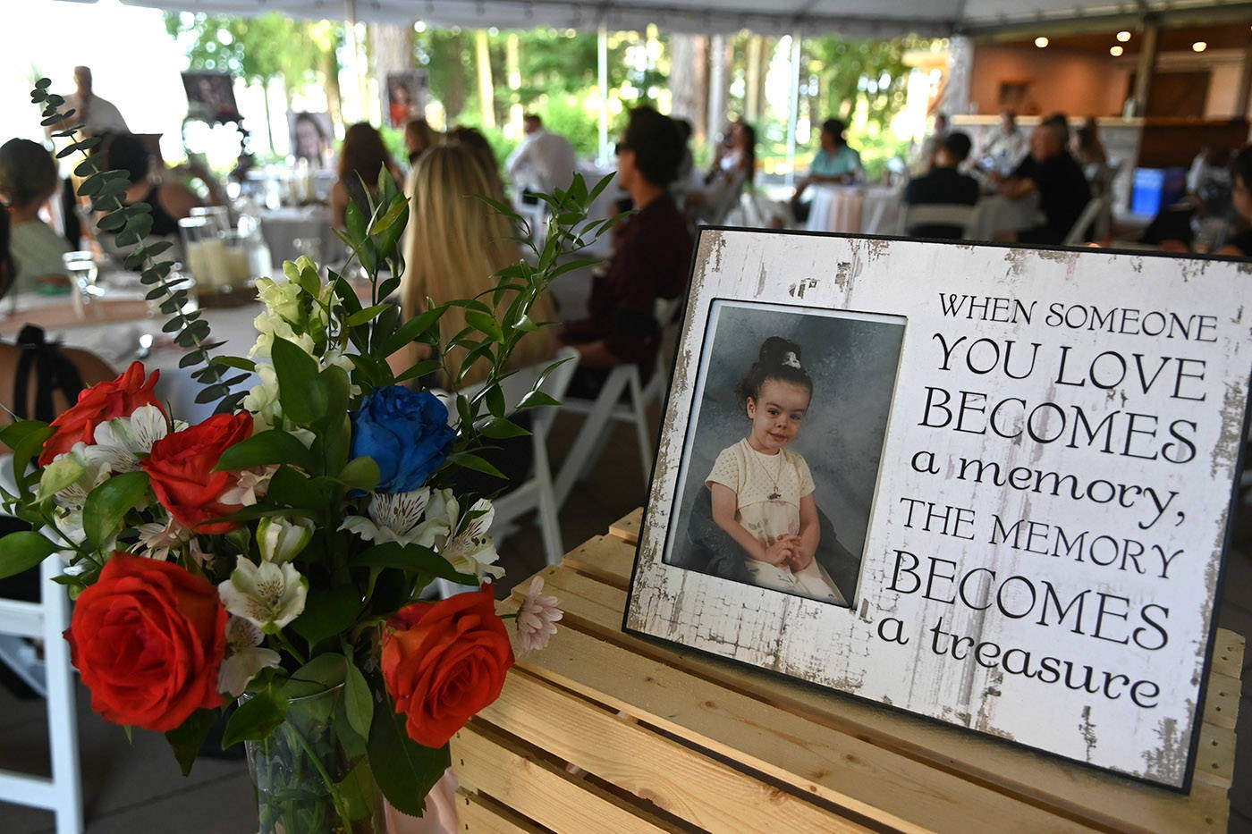 A photo of Shaelene Bell when she was a child sits on a table during her celebration of life at Sandpiper Resort on Saturday, June 26, 2021. (Jenna Hauck/ Chilliwack Progress)