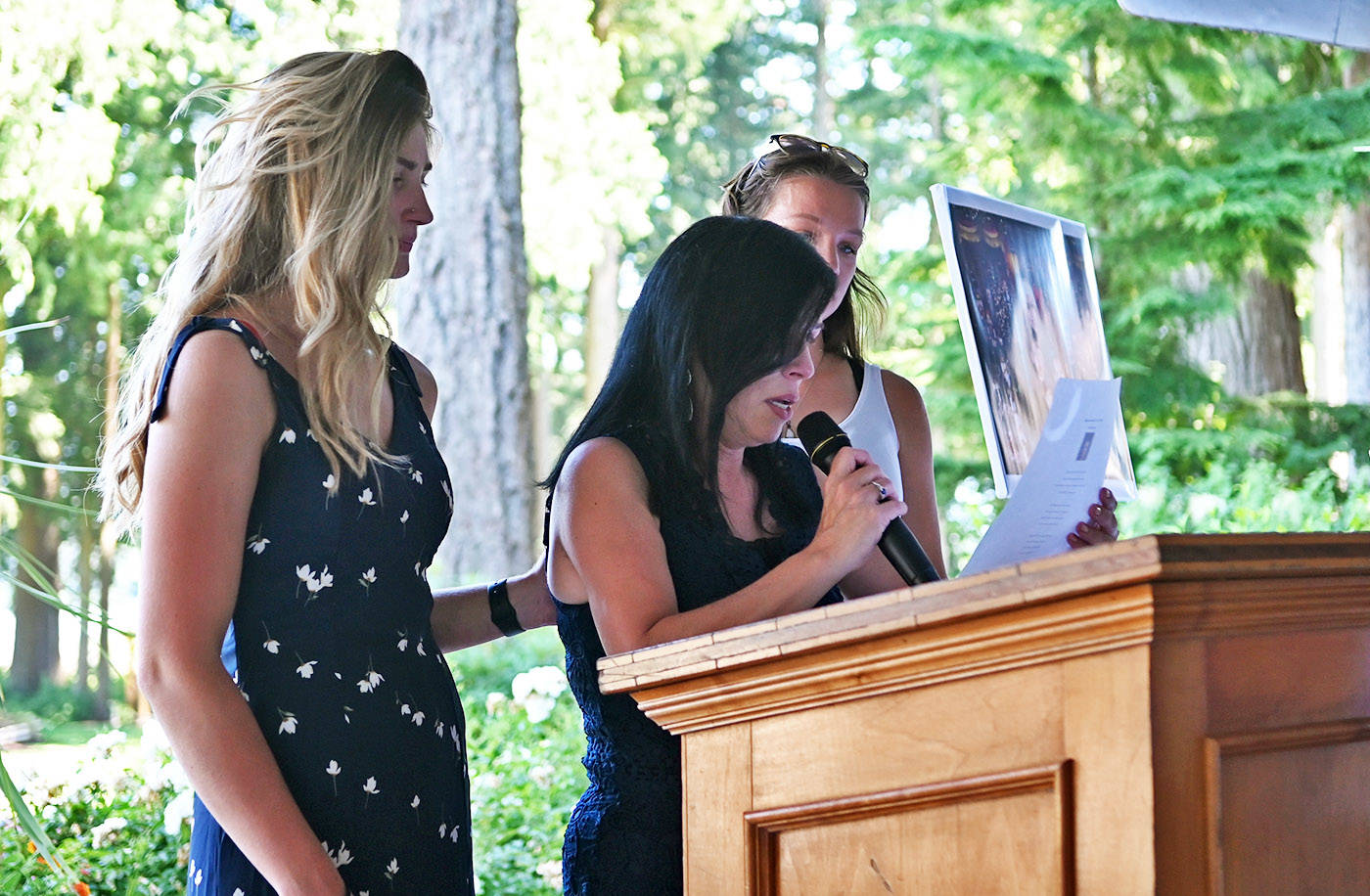 Alina Durham, mother of 23-year-old Shaelene Bell, reads a poem during her daughter's celebration of life at Sandpiper Resort on Saturday, June 26, 2021. (Jenna Hauck/ Chilliwack Progress)